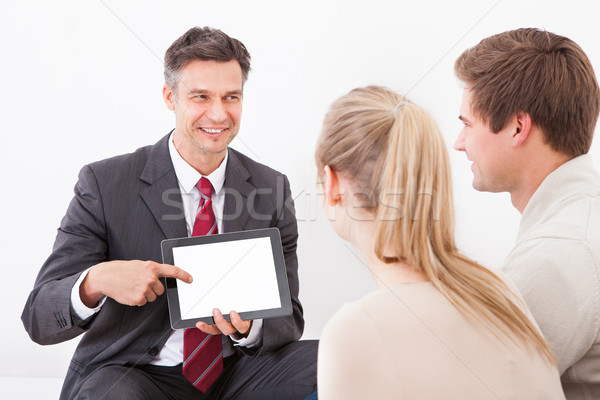 Salesman Showing Tablet Pc To Couple Stock photo © AndreyPopov