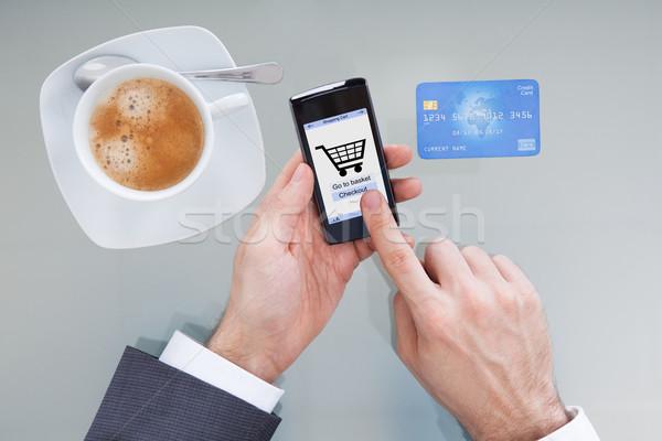 Stok fotoğraf: Işadamı · online · alışveriş · el · cep · telefonu