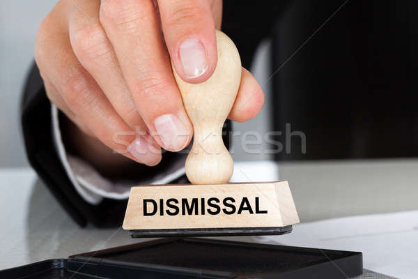 Hand Holding Rubber Stamp With Dismissal Sign Stock photo © AndreyPopov