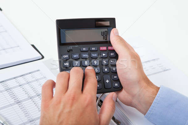 Businessman Calculating Tax In Office Stock photo © AndreyPopov