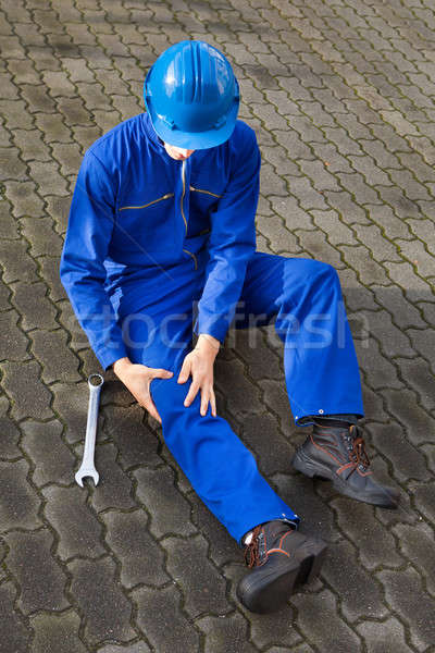 Technician Suffering From Knee Pain On Street Stock photo © AndreyPopov