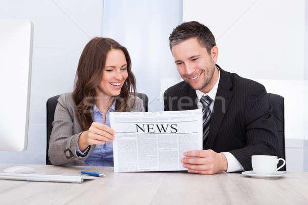 Boldog üzletemberek olvas újság irodai asztal portré Stock fotó © AndreyPopov
