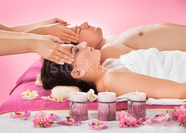 Relaxed Couple Receiving Head Massage At Spa Stock photo © AndreyPopov