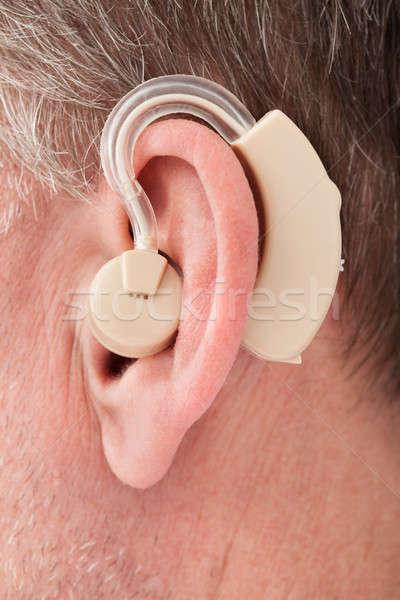 Személy visel hallókészülék közelkép orvosi technológia Stock fotó © AndreyPopov
