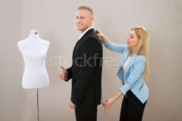 Female Tailor Taking Measurement Of Man's Suit Stock photo © AndreyPopov
