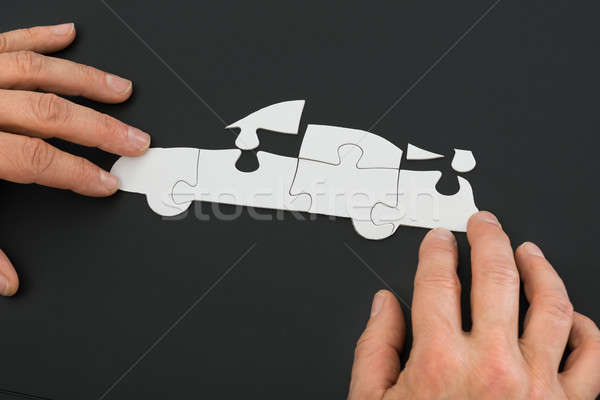 Person Solving Car Jigsaw Puzzle Stock photo © AndreyPopov