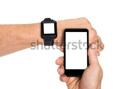 Hand With Smartwatch And Cellphone Stock photo © AndreyPopov
