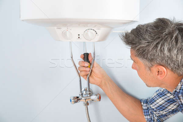 Plumber Repairing Water Heater Stock photo © AndreyPopov
