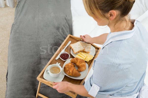 Female Maid With Breakfast Tray Stock photo © AndreyPopov