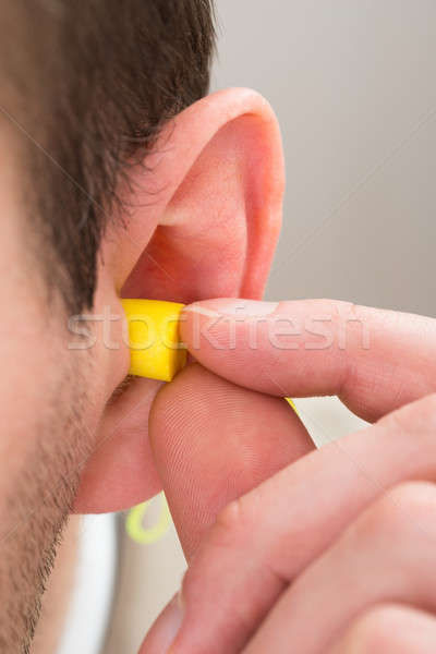 Yellow Earplug Into The Ear Stock photo © AndreyPopov