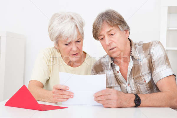 Upset Senior Couple With Letter Stock photo © AndreyPopov