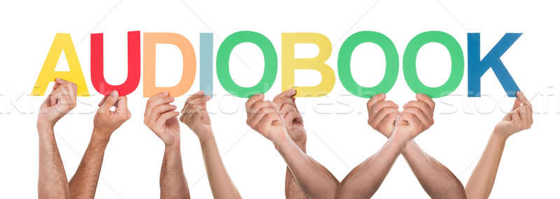 Group Of Hands Holding Multi-colored Text Audio Book Stock photo © AndreyPopov
