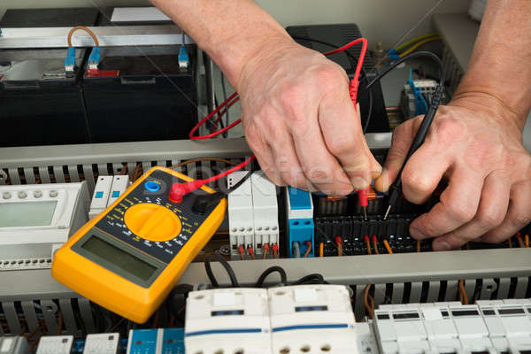 Electrician Checking Fuse Stock photo © AndreyPopov