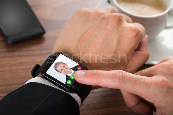 Businessman Video Calling Using Smartwatch Stock photo © AndreyPopov