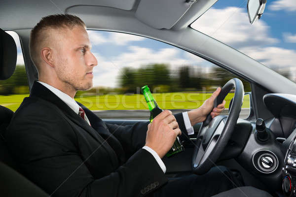 Man Drink's Beer While Driving Car Stock photo © AndreyPopov