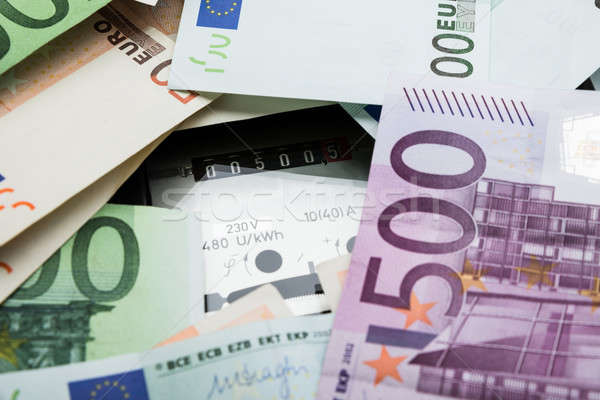 Stock photo: Euro Banknotes Over Electricity Meter