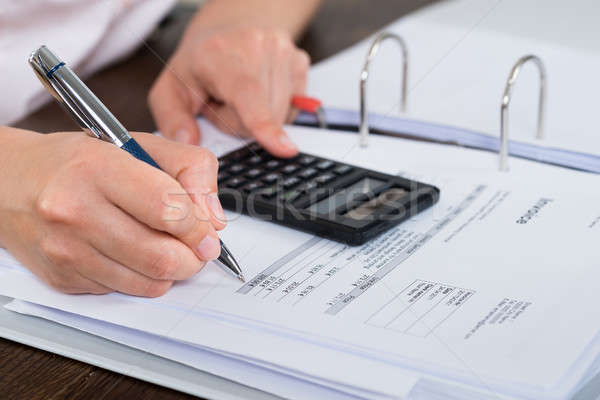 Accountant Doing Calculation Stock photo © AndreyPopov