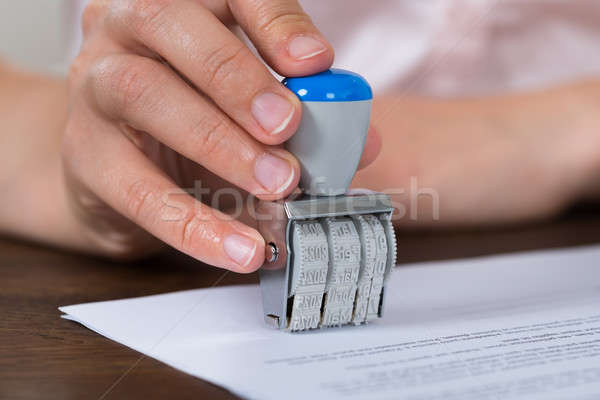 Person Hands Stamping Paper Stock photo © AndreyPopov