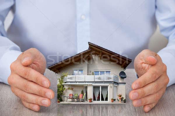 Man Saving House Model Stock photo © AndreyPopov