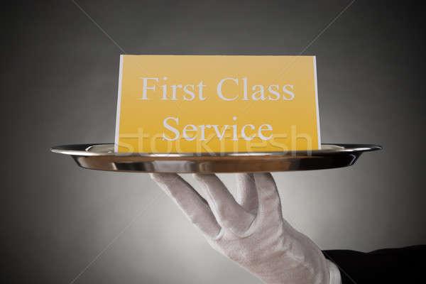 Tányér szöveg első osztály szolgáltatás tábla közelkép Stock fotó © AndreyPopov