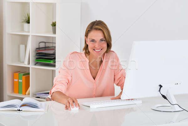 Woman Working On Desktop Computer Stock photo © AndreyPopov