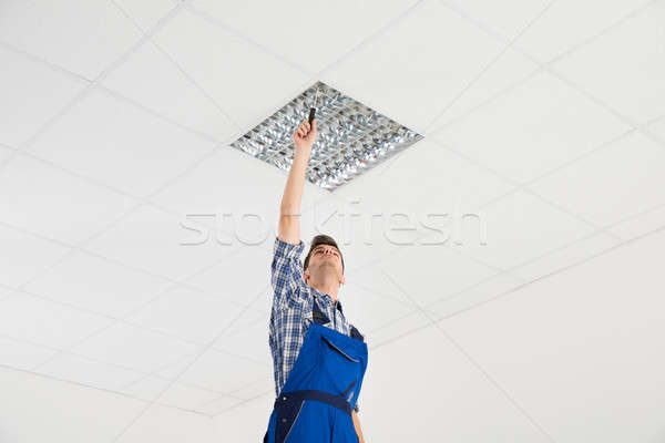 Electrician Installing Ceiling Light Stock photo © AndreyPopov