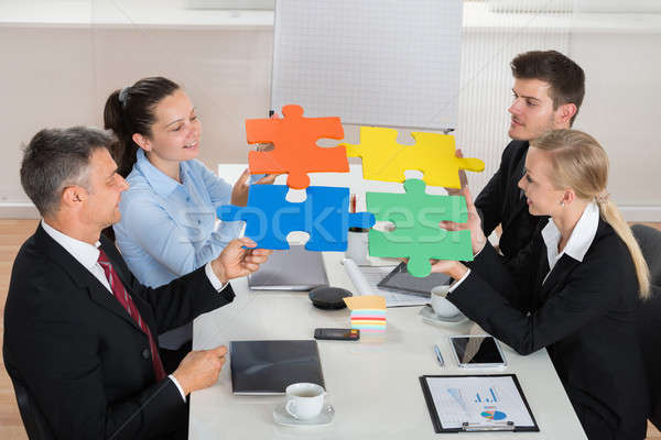 Businesspeople Joining Puzzle Piece Stock photo © AndreyPopov