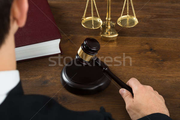 Judge Hitting Mallet In Courtroom Stock photo © AndreyPopov