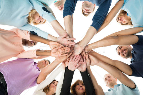 Creative Business Team Stacking Hands In Huddle Stock photo © AndreyPopov