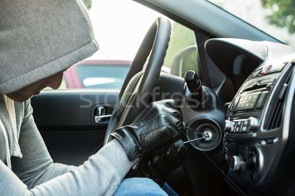Thief Using Tool In Car Stock photo © AndreyPopov