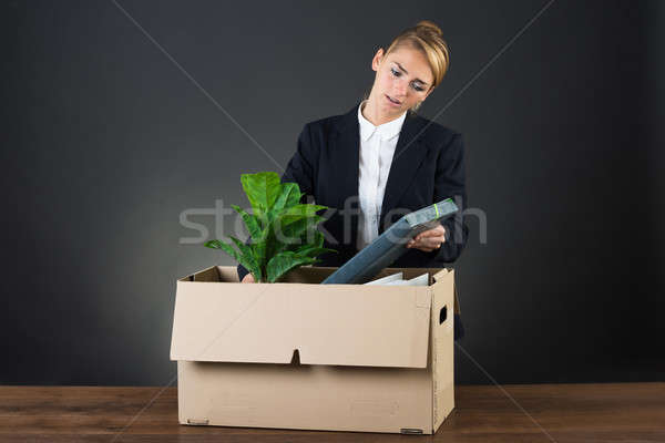 Sad Businesswoman Packing Her Belongings At Desk Stock photo © AndreyPopov