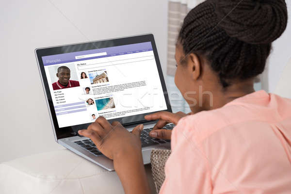 Woman Chatting On Social Networking Site Stock photo © AndreyPopov