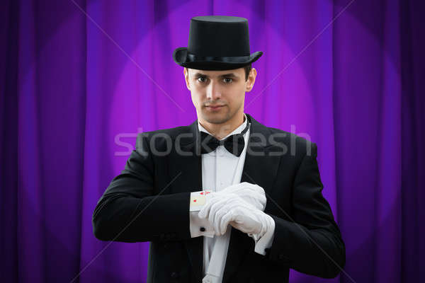Stock photo: Portrait Of Magician Performing Trick With Cards