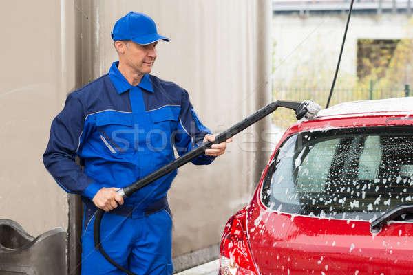 Сток-фото: мужчины · работник · стиральные · красный · автомобилей · гаража