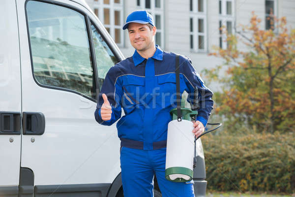 Pest Control Worker Showing Thumbsup By Truck Stock photo © AndreyPopov