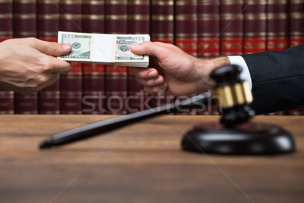 Gavel On Table With Judge Taking Bribe From Businessman Stock photo © AndreyPopov