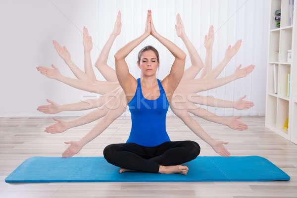 Kitettség nő kéz meditál fiatal nő testmozgás Stock fotó © AndreyPopov