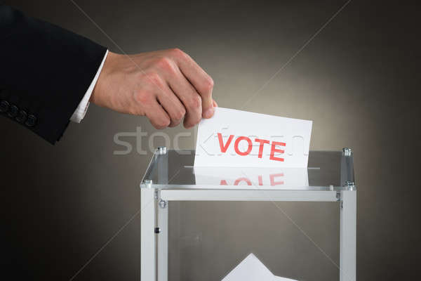 Businessperson Hand Putting Vote Into A Ballot Box Stock photo © AndreyPopov