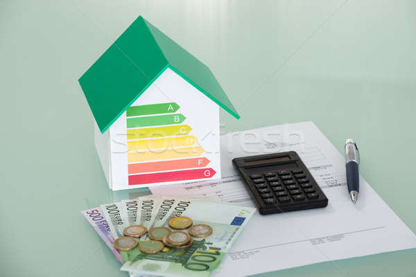 Energy Efficiency Rate With Invoice And Currency Stock photo © AndreyPopov