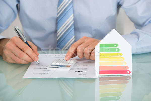 Empresário eficiência energética taxa casa escritório Foto stock © AndreyPopov