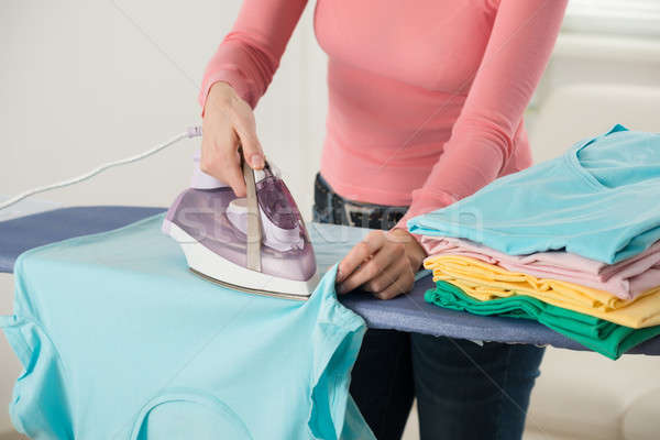 Woman Hand Ironing Clothes Stock photo © AndreyPopov