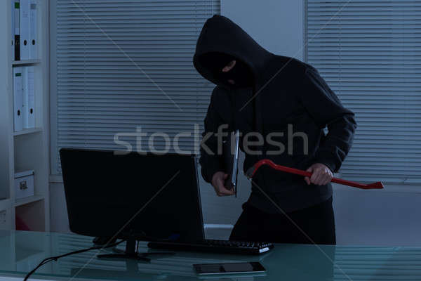 Thief Stealing Laptop Stock photo © AndreyPopov