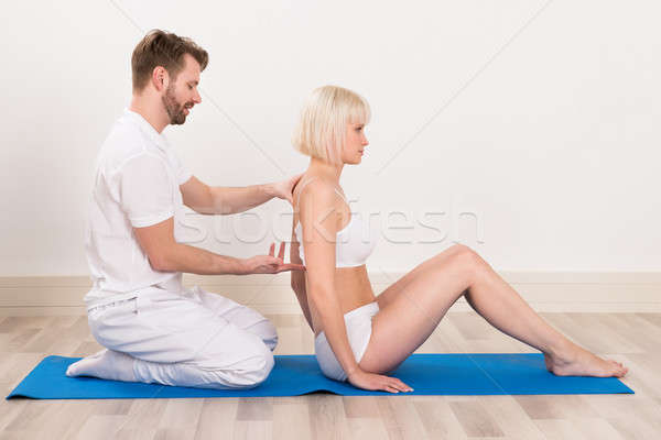 Male Chiropractor Doing Physio Therapy  Stock photo © AndreyPopov