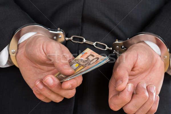 Işadamı kelepçe tutuklandı iş para Stok fotoğraf © AndreyPopov