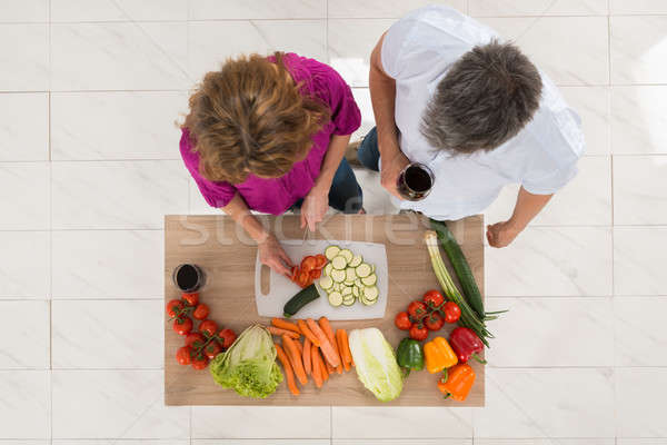 High Angle View Of Couple Preparing Food Stock photo © AndreyPopov