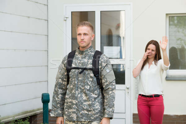 Ongelukkig vrouw vaarwel mannelijke soldaat Stockfoto © AndreyPopov