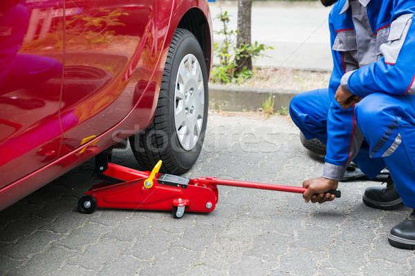 Mechanic Putting Hydraulic Floor Jack Inside The Car Stock photo © AndreyPopov