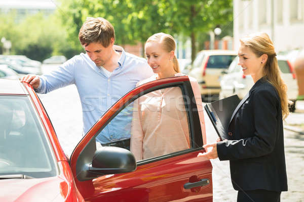 Couple Looking At New Car Stock photo © AndreyPopov