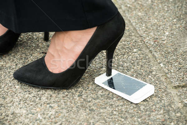 Damaged Mobile Phone Screen With High Heel On It Stock photo © AndreyPopov