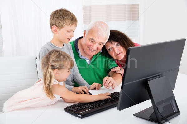 Multi Generation Family Using Desktop Together At Home Stock photo © AndreyPopov